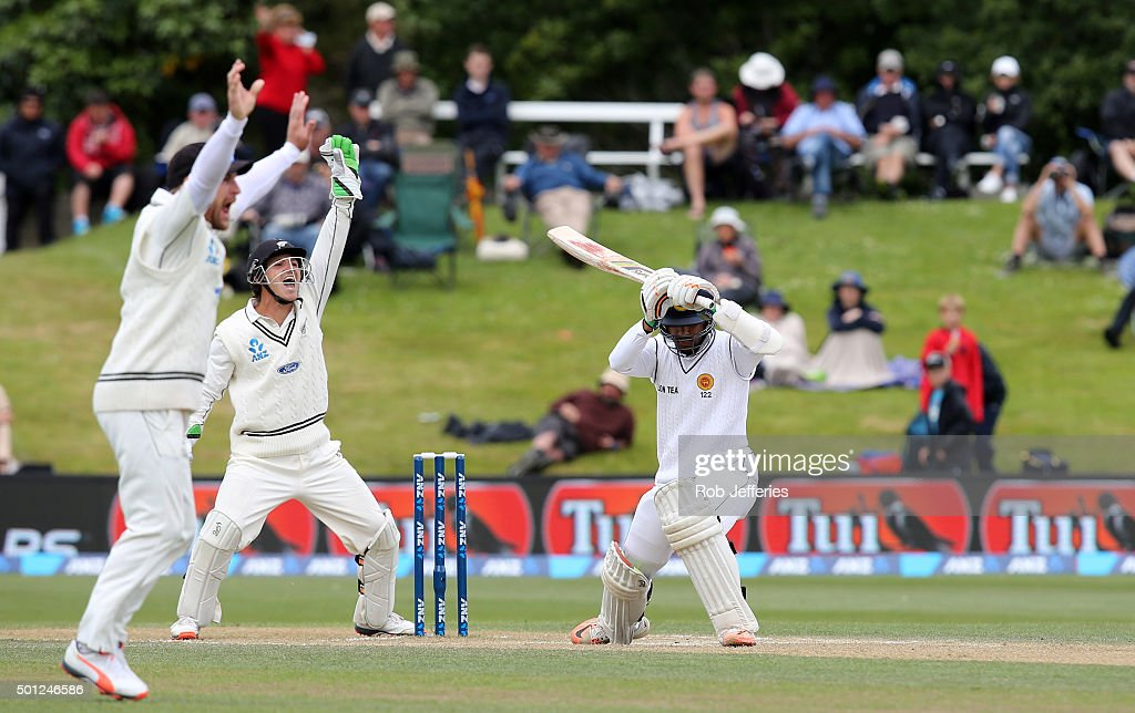 Brendon McCullum and BJ Watling of New Zealand successfully appeal for an LBW decision as Dinesh Chandimal of Sri Lanka looks on during day five of the First Test match between New Zealand and Sri Lanka at University Oval on December 14, 2015 in Dunedin, New Zealand.