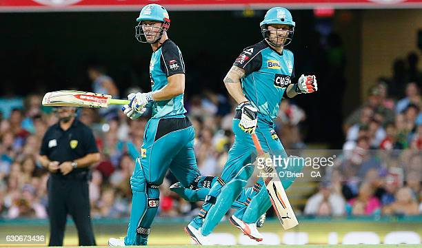 Brendon McCullum and Chris Lynn during the Big Bash League between the Brisbane Heat and Hobart Hurricanes at The Gabba on December 30 2016 in...
