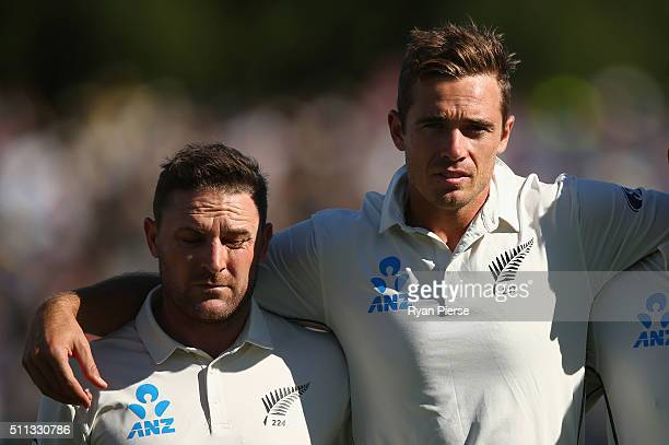 Brendon McCullum and Tim Southee of New Zealand sing the anthem during day one of the Test match between New Zealand and Australia at Hagley Oval on...