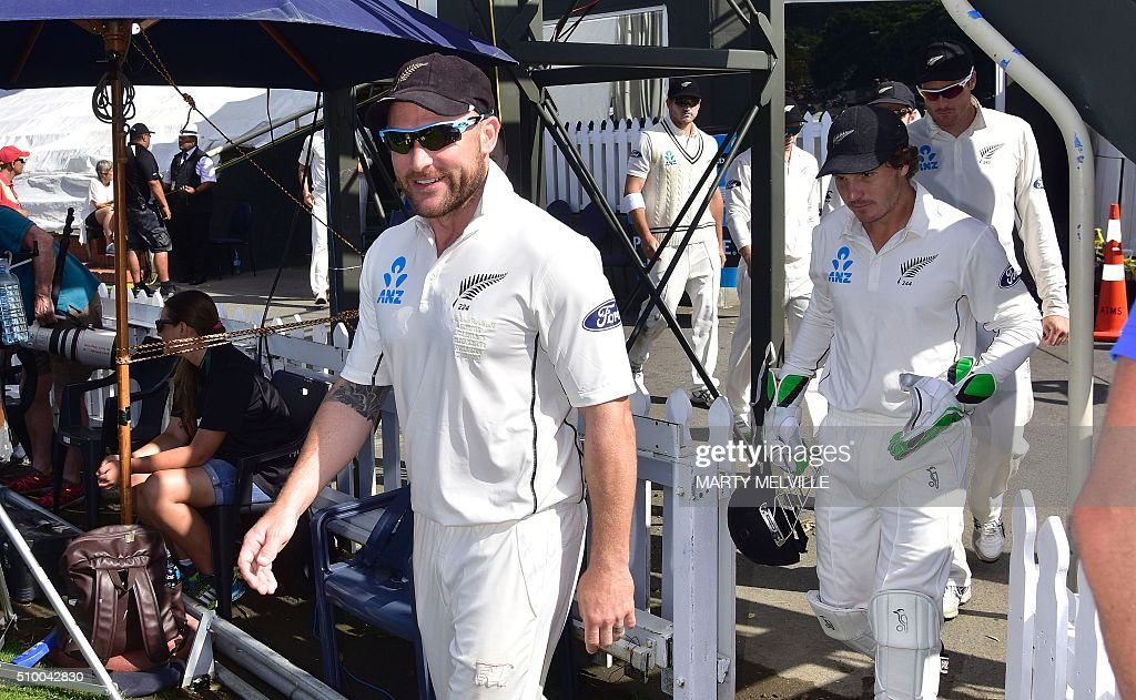 Brendon McCullum captain of New Zealand leads out his team at the start of play during day three of the first cricket Test match between New Zealand and Australia at the Basin Reserve in Wellington on February 14, 2016. / AFP / Marty Melville
