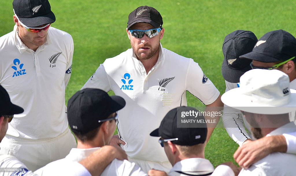 Brendon McCullum captain of New Zealand speaks to his team at the start of play during day three of the first cricket Test match between New Zealand and Australia at the Basin Reserve in Wellington on February 14, 2016. / AFP / Marty Melville