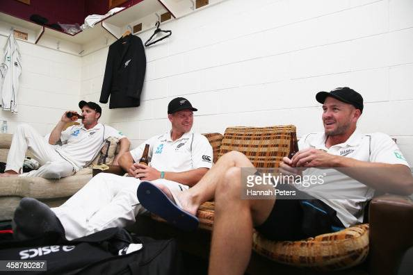 Brendon McCullum Corey Anderson and Peter Fulton of New Zealand celebrate in the dressing room after winning the Third Test match between New Zealand...