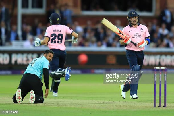 Brendon McCullum of Middlesex hits the ball back past Ravi Rampaul of Surrey during the NatWest T20 Blast match between Middlesex and Surrey at...