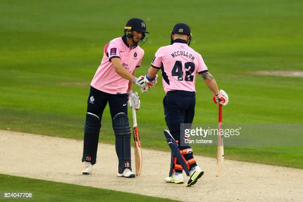 Brendon McCullum of Middlesex taps gloves with partner John Simpson during the NatWest T20 Blast South Group match between Sussex Sharks and...