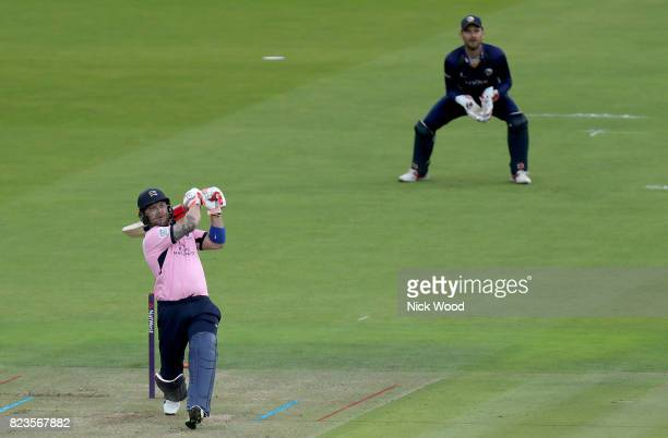 Brendon McCullum of Middlesex watches the ball sail over the rope for six during the Middlesex v Essex NatWest T20 Blast cricket match at the Lords...