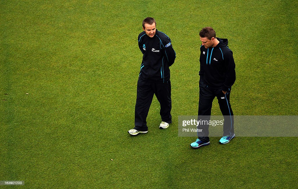 <a gi-track='captionPersonalityLinkClicked' href=/galleries/search?phrase=Brendon+McCullum&family=editorial&specificpeople=208154 ng-click='$event.stopPropagation()'>Brendon McCullum</a> of New Zealand (R) and coach Mike Hesson (L) survey the conditions as rain delays the start of play on day five of the second test match between New Zealand and England at the Basin Reserve on March 18, 2013 in Wellington, New Zealand.