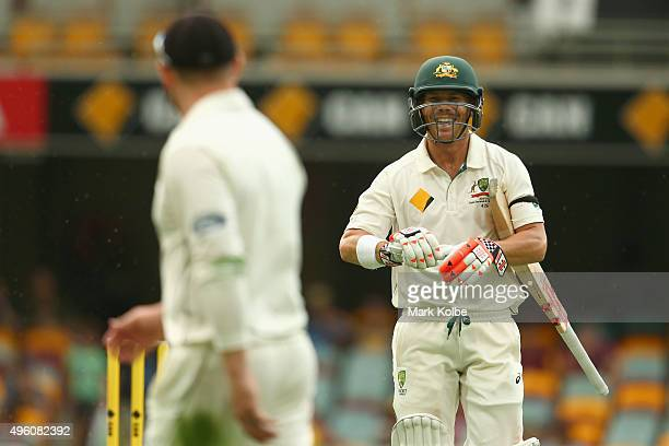 Brendon McCullum of New Zealand and David Warner of Australia share a joke during day three of the First Test match between Australia and New Zealand...