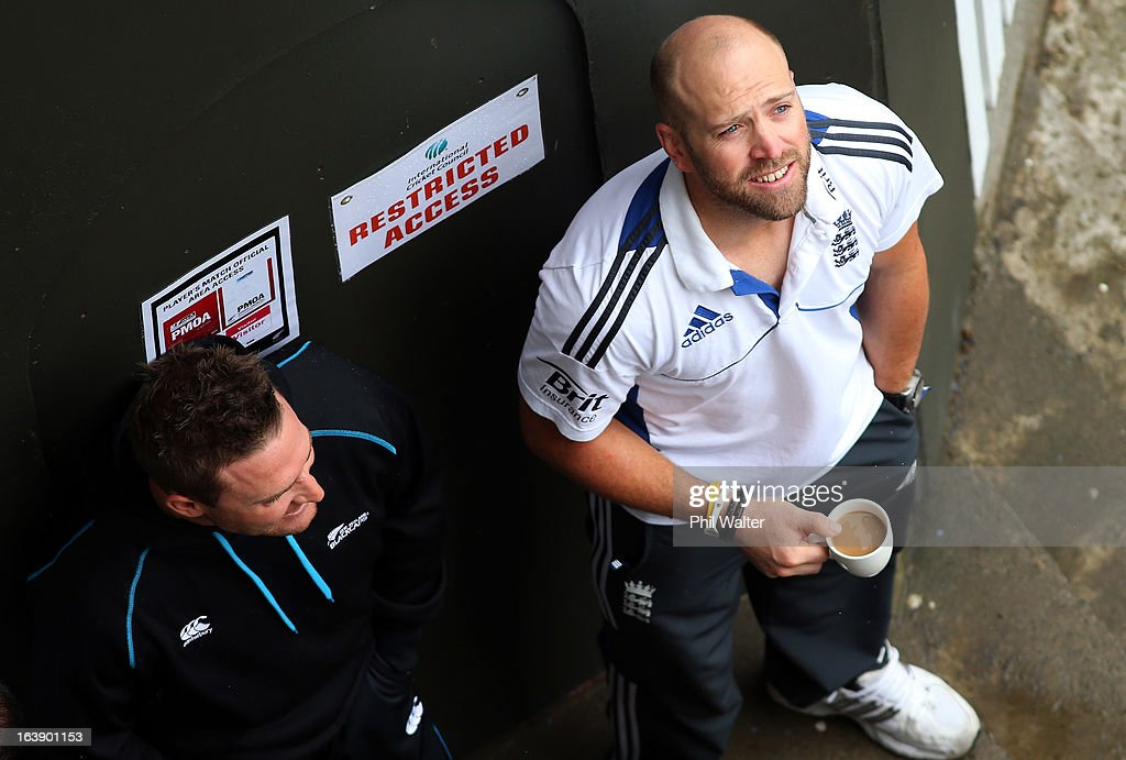 Brendon McCullum of New Zealand (L) and Matt Prior (R) of England survey the conditions as rain delays the start of play on day five of the second test match between New Zealand and England at the Basin Reserve on March 18, 2013 in Wellington, New Zealand.