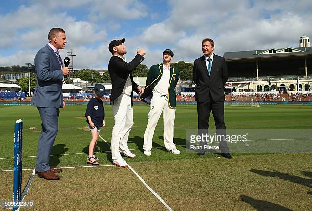 Brendon McCullum of New Zealand and Steve Smith of Australia toss the coin during day one of the Test match between New Zealand and Australia at...