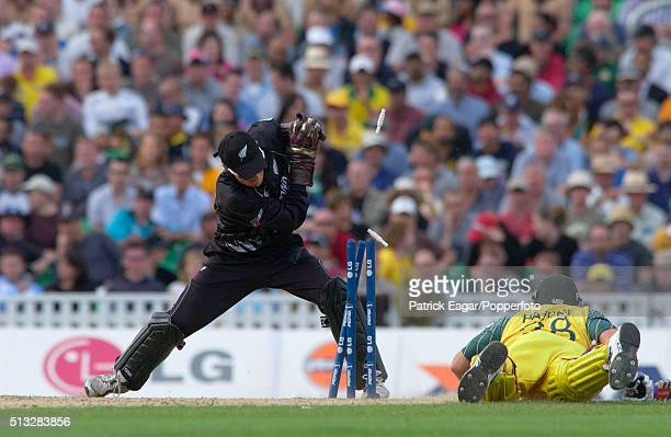 Brendon McCullum of New Zealand attempts to run out Matthew Hayden of Australia during the ICC Champions Trophy match between Australia and New...