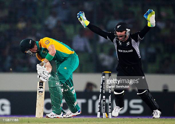 Brendon McCullum of New Zealand celebrates as Johan Botha of South Africa is bowled by Jacob Oram during the 2011 ICC World Cup QuarterFinal match...