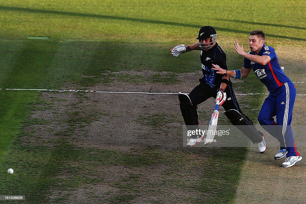<a gi-track='captionPersonalityLinkClicked' href=/galleries/search?phrase=Brendon+McCullum&family=editorial&specificpeople=208154 ng-click='$event.stopPropagation()'>Brendon McCullum</a> of New Zealand clashes with Luke Wright of England during the international Twenty20 match between New Zealand and England at Seddon Park on February 12, 2013 in Hamilton, New Zealand.