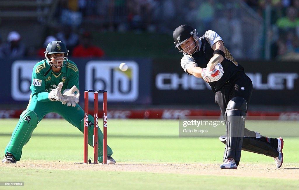 <a gi-track='captionPersonalityLinkClicked' href=/galleries/search?phrase=Brendon+McCullum&family=editorial&specificpeople=208154 ng-click='$event.stopPropagation()'>Brendon McCullum</a> of New Zealand drives one into the waiting hands of Justin Ontong of South Africa during the 3rd T20 International match between South Africa and New Zealand at AXXESS St Georges on December 26, 2012 in Port Elizabeth, South Africa.