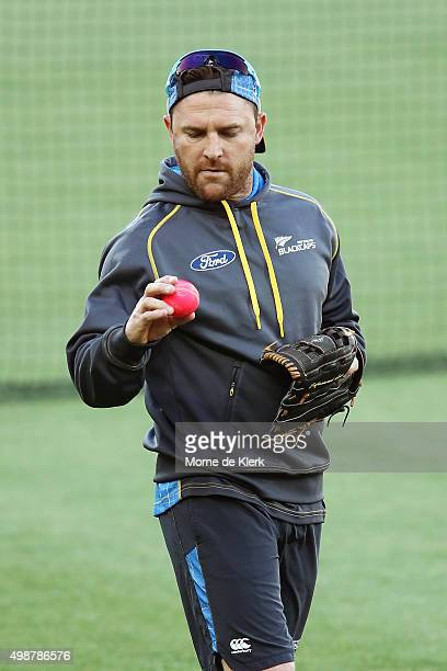 Brendon McCullum of New Zealand inspects a pink cricket ball during a New Zealand training session at Adelaide Oval on November 26 2015 in Adelaide...