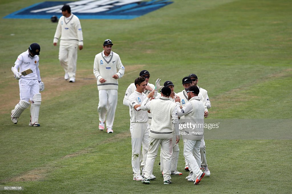 Brendon McCullum of New Zealand is congratulated by his teammates after pulling in a spectacular catch to dismiss Milinda Siriwardana of Sri Lanka...