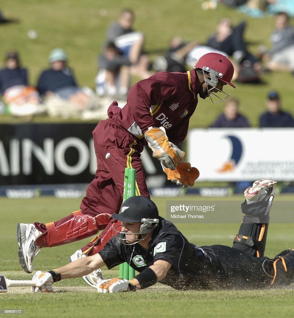 Brendon McCullum of New Zealand is run out for 45 by Danesh Ramdin during the second one day international cricket match between New Zealand and the...