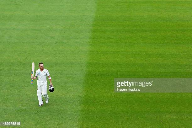 Brendon McCullum of New Zealand leaves the field dismissed for 302 runs moments after reaching 300 runs for New Zealand's first ever triple century...
