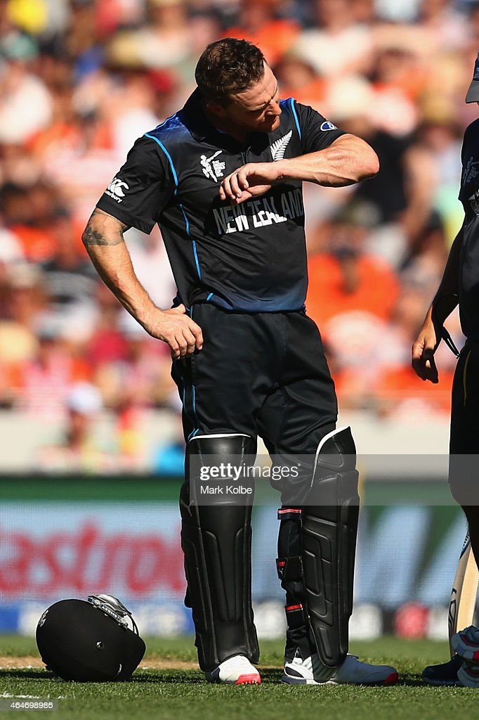 Brendon McCullum of New Zealand looks at his injured arm after being hit by a ball bowled by Mitchell Johnson of Australia during the 2015 ICC...