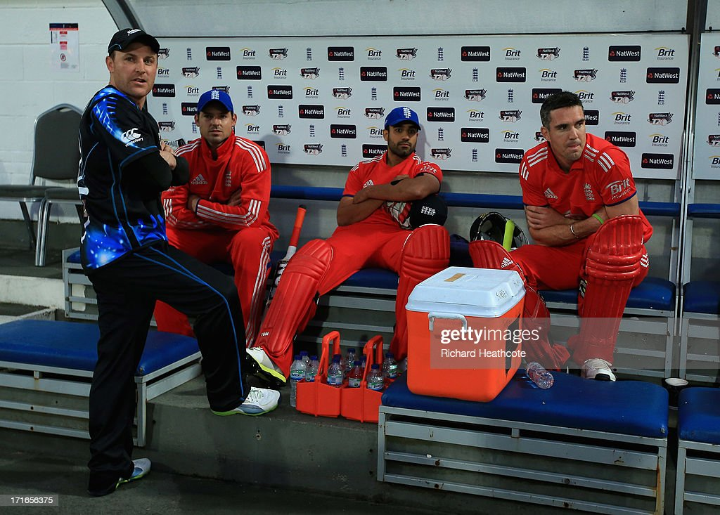 <a gi-track='captionPersonalityLinkClicked' href=/galleries/search?phrase=Brendon+McCullum&family=editorial&specificpeople=208154 ng-click='$event.stopPropagation()'>Brendon McCullum</a> of New Zealand, Michael Lumb, <a gi-track='captionPersonalityLinkClicked' href=/galleries/search?phrase=Ravi+Bopara&family=editorial&specificpeople=4106027 ng-click='$event.stopPropagation()'>Ravi Bopara</a> and <a gi-track='captionPersonalityLinkClicked' href=/galleries/search?phrase=Kevin+Pietersen+-+Cricket+Player&family=editorial&specificpeople=202001 ng-click='$event.stopPropagation()'>Kevin Pietersen</a> of England sit in the dug out as the game is abandoned during the 2nd Natwest International T20 match between England and New Zealand at The Kia Oval on June 27, 2013 in London, England.