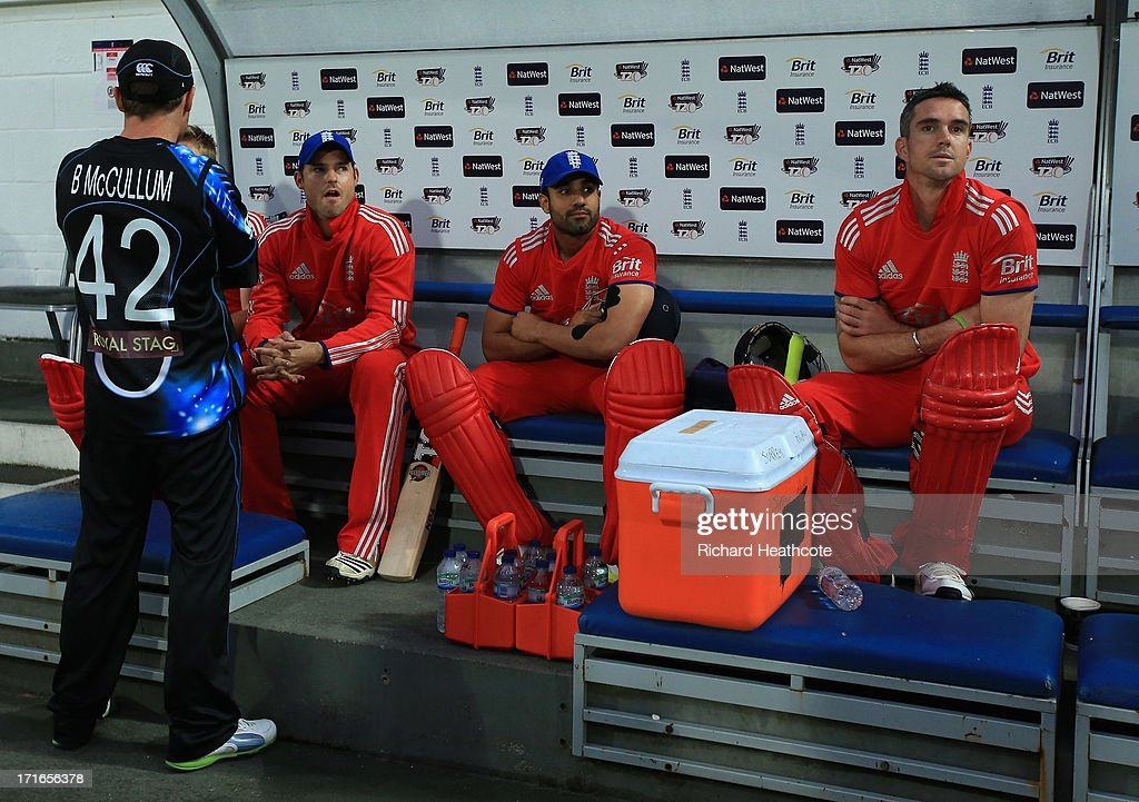 Brendon McCullum of New Zealand, Michael Lumb, Ravi Bopara and Kevin Pietersen of England sit in the dug out as the game is abandoned during the 2nd Natwest International T20 match between England and New Zealand at The Kia Oval on June 27, 2013 in London, England.