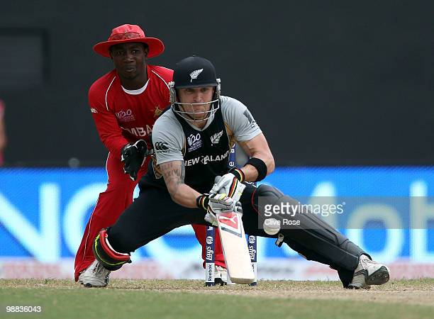 Brendon McCullum of New Zealand plays a scoop shot during the ICC T20 World Cup Group B match between New Zealand and Zimbabwe at the Guyana National...