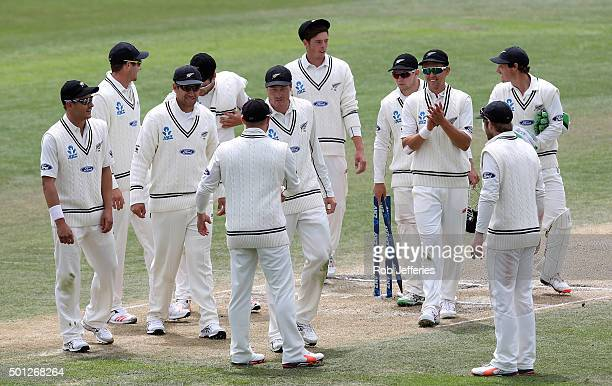 Brendon McCullum of New Zealand shakes the hand of Martin Guptill after he was named man of the match at the end of day five of the First Test match...