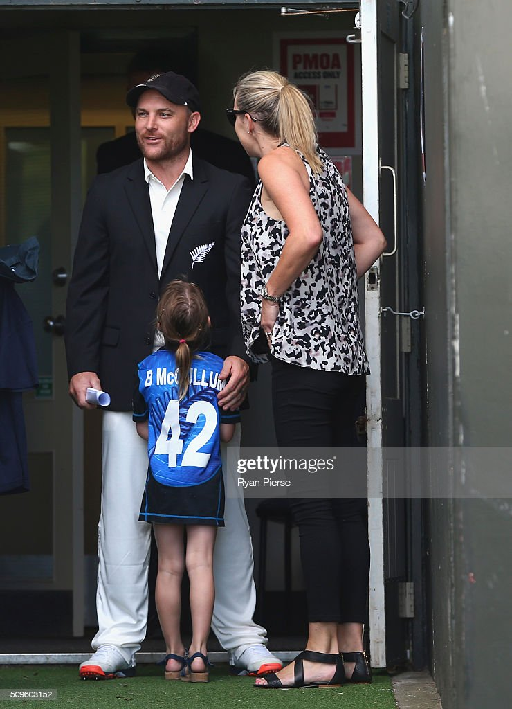 Brendon McCullum of New Zealand speaks with his wife Ellissa McCullum and daughter Maya McCullum before his 100th test during day one of the Test match between New Zealand and Australia at Basin Reserve on February 12, 2016 in Wellington, New Zealand.