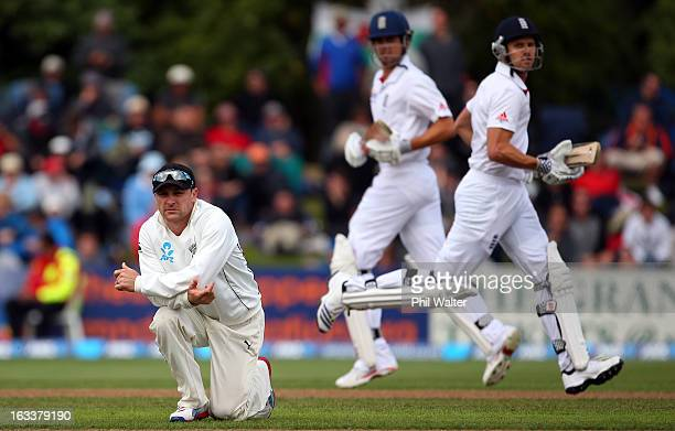 Brendon McCullum of New Zealand watchs the ball travel to the boundary as Alastair Cook and Nick Compton of England make runs during day four of the...