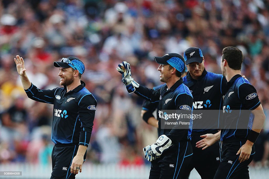 Brendon McCullum of the Black Caps and Luke Ronchi of the Black Caps celebrate the wicket of David Warner of Australia during the 3rd One Day International cricket match between the New Zealand Black Caps and Australia at Seddon Park on February 8, 2016 in Hamilton, New Zealand.