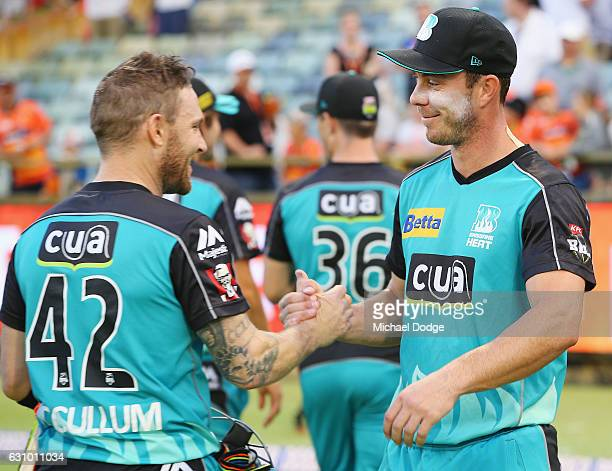 Brendon McCullum of the Heat and Chris Lynn of the Heat comes off undefeated on 98 after hitting the winning runs during the Big Bash League match...