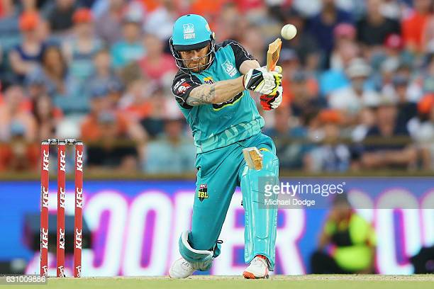 Brendon McCullum of the Heat breaks his bat from this stroke during the Big Bash League match between the Perth Scorchers and the Brisbane Heat at...