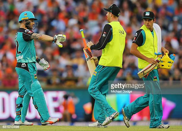 Brendon McCullum of the Heat gets a new bat hands back his broken bat after playing a stoke off the bowling of Andrew Tye of the Scorchers during the...