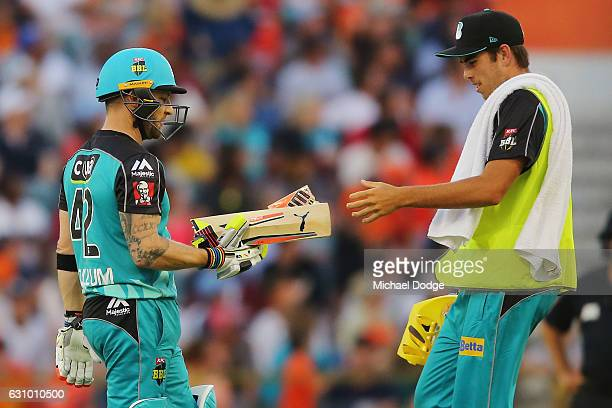Brendon McCullum of the Heat hands back his broken bat after playing a stoke off the bowling of Andrew Tye of the Scorchers during the Big Bash...
