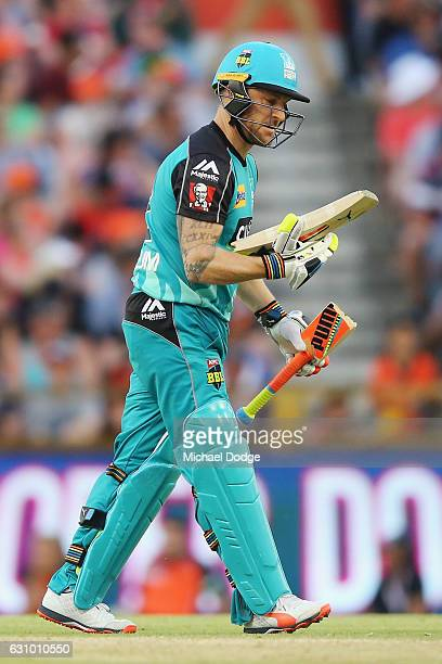 Brendon McCullum of the Heat reacts after breaking his bat from playing a stoke off the bowling of Andrew Tye of the Scorchers during the Big Bash...