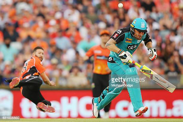 Brendon McCullum of the Heat survives a runout attempt by Andrew Tye of the Scorchers during the Big Bash League match between the Perth Scorchers...
