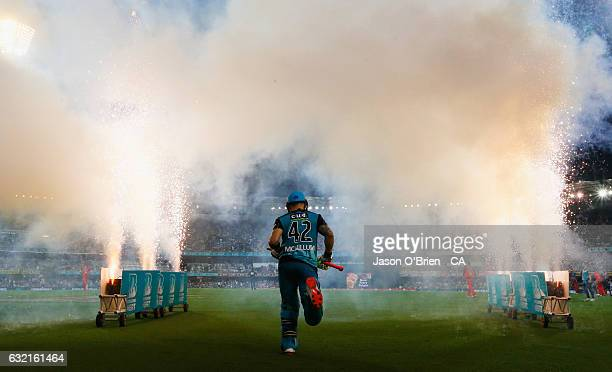 Brendon McCullum of the Heat walks out to bat during the Big Bash League match between the Brisbane Heat and the Melbourne Renegades at The Gabba on...