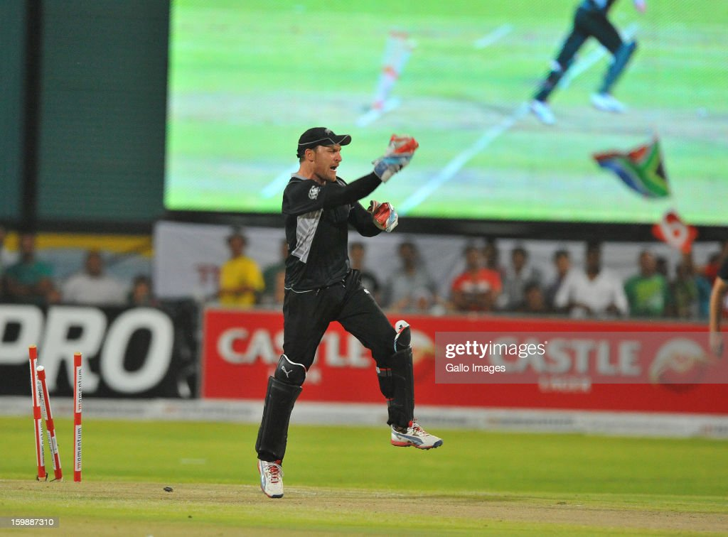 <a gi-track='captionPersonalityLinkClicked' href=/galleries/search?phrase=Brendon+McCullum&family=editorial&specificpeople=208154 ng-click='$event.stopPropagation()'>Brendon McCullum</a> runs out Farhaan Behardien of South Africa for 30 runs during the 2nd One Day International match between South Africa and New Zealand at De Beers Diamond Oval on January 22, 2013 in Kimberley, South Africa.