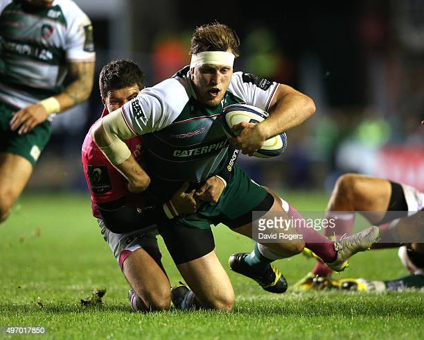 Brendon O'Connor of Leicester is tackled by Morne Steyn during the Eurpean Rugby Champions Cup match between Leicester Tigers and Stade Francais at...