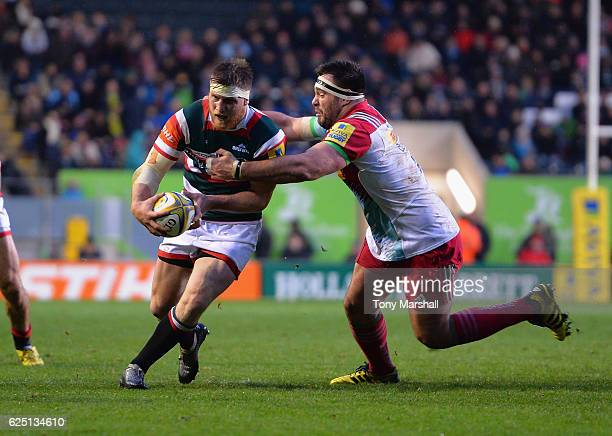 Brendon O'Connor of Leicester Tigers is tackled by Will Collier of Harlequins during the Aviva Premiership match between Leicester Tigers and...
