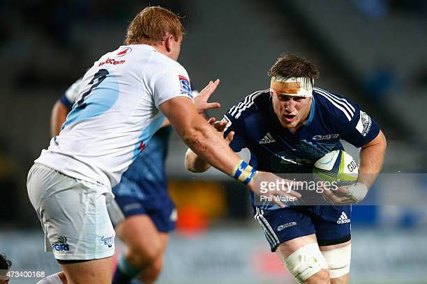 Brendon O'Connor of the Blues is tackled by Adriaan Strauss of the Bulls during the round 14 Super Rugby match between the Blues and the Bulls at...