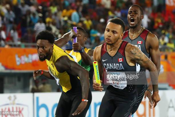 Brendon Rodney hands the baton to Andre De Grasse of Canada in the Men's 4x200 Metres Relay Final during the IAAF/BTC World Relays Bahamas 2017 at...