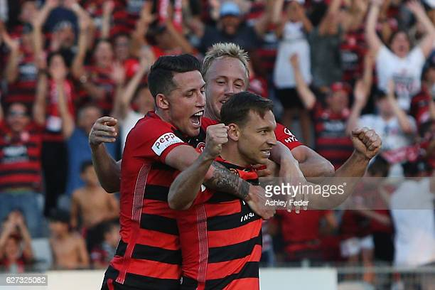 Brendon Santalab Mitch Nichols and Scott Neville of the Wanderers celebrate a goal during the round nine ALeague match between Central Coast Mariners...