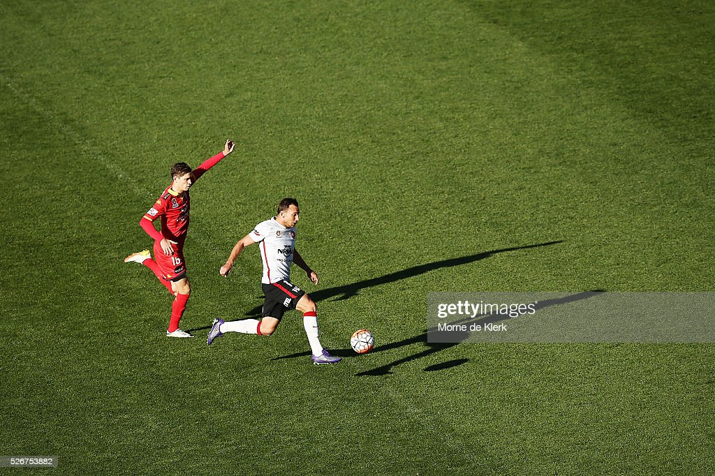 Brendon Santalab of the Wanderers and Craig Goodwin of Adelaide United compete for the ball during the 2015/16 A-League Grand Final match between Adelaide United and the Western Sydney Wanderers at the Adelaide Oval on May 1, 2016 in Adelaide, Australia.