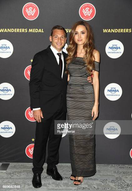 Brendon Santalab of the Wanderers and parnter Stephanie Baynie arrive ahead of the Western Sydney Wanderers Medal Night at the International...