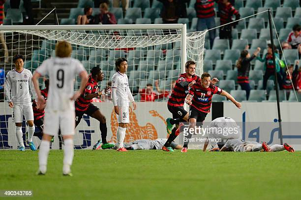 Brendon Santalab of the Wanderers celebrates after scoring his teams second goal during the AFC Asian Champions League match between the Western...