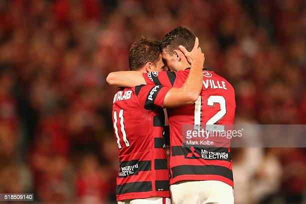 Brendon Santalab of the Wanderers celebrates with his team mate Scott Neville of the Wanderers after scoring a goal during the round 26 ALeague match...