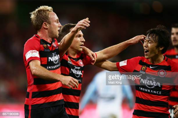 Brendon Santalab of the Wanderers celebrates with Mitch Nichols and Jumpei Kusukami after scoring a goal during the round 24 ALeague match between...