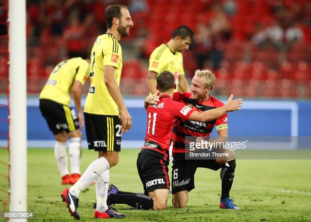 Brendon Santalab of the Wanderers celebrates with team mate Mitch Nichols after scoring his second goal during the round 23 ALeague match between the...