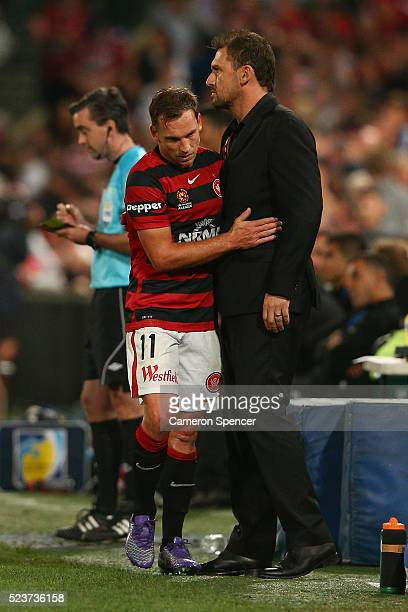 Brendon Santalab of the Wanderers embraces Wanderers coach Tony Popovic as he leaves the field during the ALeague Semi Final match between the...