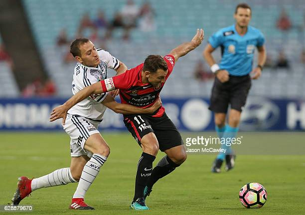 Brendon Santalab of the Wanderers is challenged by Alan Baro of the Victory during the round 10 ALeague match between the Western Sydney Wanderers...